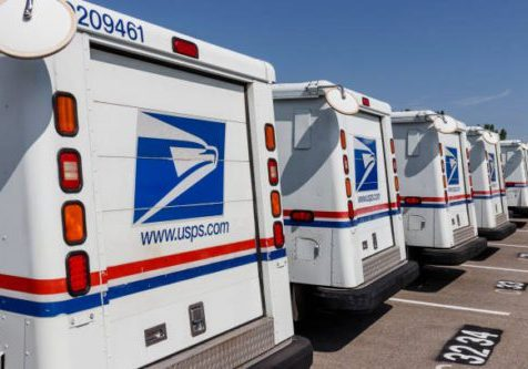 Indianapolis - Circa August 2019: USPS Post Office Mail Trucks. The Post Office is responsible for providing mail delivery VIII